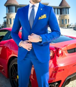red ferrari guy in expensive suit